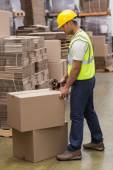 Worker preparing goods for dispatch — Stock Photo