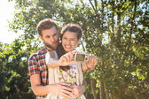 Hipster couple taking selfie — Stock Photo