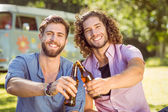 Hipster friends toasting with beers — Stock Photo