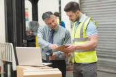 Workers scanning package in warehouse — Stock Photo