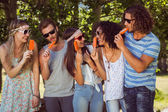 Hipster friends enjoying ice lollies — Stock Photo