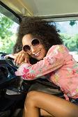 Pretty hipster driving camper van — Stock fotografie