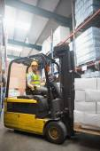 Smiling driver operating forklift machine — 图库照片