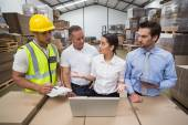 Warehouse managers and worker talking — Stock Photo