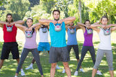 Fitness group working out in park with kettle bells  — Stock Photo