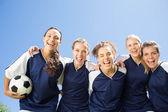 Pretty football players smiling at camera — Stock Photo
