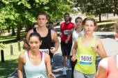 Fit people running race in park — Stock Photo