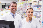 Team of pharmacists looking at camera — Stock Photo