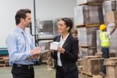 Warehouse managers holding box — Stock Photo