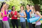 Fitness group chatting in park — Stock Photo