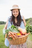 Pretty woman with basket of veg — Stock Photo