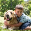 Little boy with his dog in the park — Stock Photo #69020543