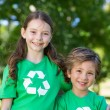 Happy siblings in green smiling — Stock Photo #69020665