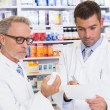 Pharmacist looking medication for prescription — Stock Photo #69020813