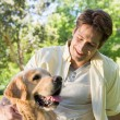 Happy man with his pet dog in park — Stock Photo #69021165