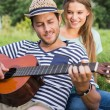 Cute couple relaxing in the park — Stock Photo #69021303