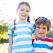 Happy siblings smiling at camera — Stock Photo #69021373