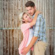 Handsome man hugging his girlfriend — Stock Photo #69028569