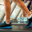 Row of people working out on treadmills — Stock Photo #69029123