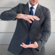 Businessman gesturing with his hands — Stock Photo #69029939