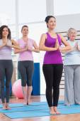 Female friends with hands clasped exercising in gym — Stock Photo