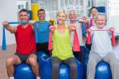 People exercising with resistance bands in gym class — Foto de Stock