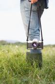 Woman in the park holding retro camera — Stock Photo