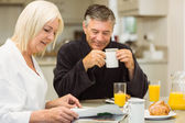 Mature couple having breakfast together — Stock Photo