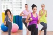 Women practicing kickboxing at fitness studio — Stock Photo