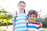 Happy siblings smiling at camera — Stock Photo