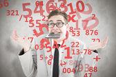 Naukowy wzruszając biznesmen gryzienie kalkulator — Zdjęcie stockowe