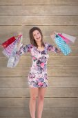 Woman standing with shopping bag — Stock Photo