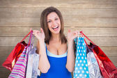 Brunette woman holding shopping bags — Stock Photo