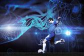 Composite image of football player kicking ball — Stock Photo