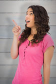Surprised brown haired woman pointing out — Stock Photo