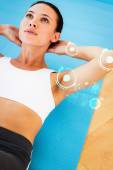 Determined young woman doing abdominal crunch — Stock Photo