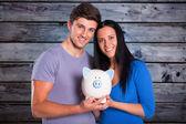 Couple holding a piggy bank — Stock Photo