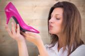 Young woman about kissing a shoes — Stock Photo