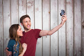 Couple taking selfie with digital camera — Stock Photo