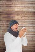 Man in winter fashion sneezing — Stock Photo