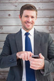 Businessman sending a text message — Stock Photo