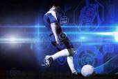 Football player kicking ball — Stock Photo