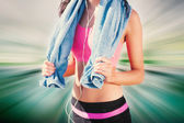 Mid section of healthy woman with towel — Stock Photo