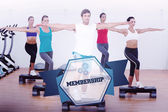 Word membership and fitness class performing step aerobics — Stock Photo