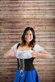 Oktoberfest girl showing thumbs up — Stockfoto