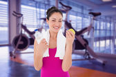 Fit woman against spin bikes — Stock Photo