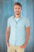 Handsome man posing with hands in pockets — Stock Photo