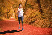 Focused fit blonde jogging — Stockfoto