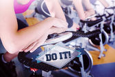 The word do it! and spin class working out in a row — Stock Photo