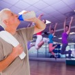 Senior man drinking from water bottle — Stock Photo #69032265